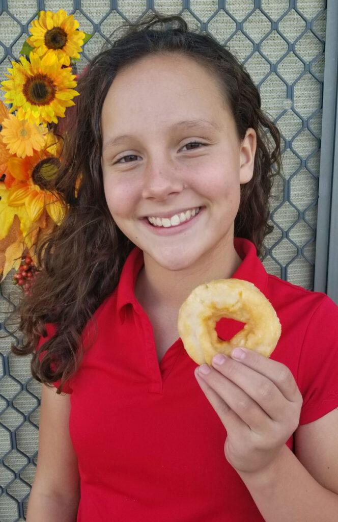 Girl with Entenmann's donut #Entenmanns #EntenMANofTheYear
