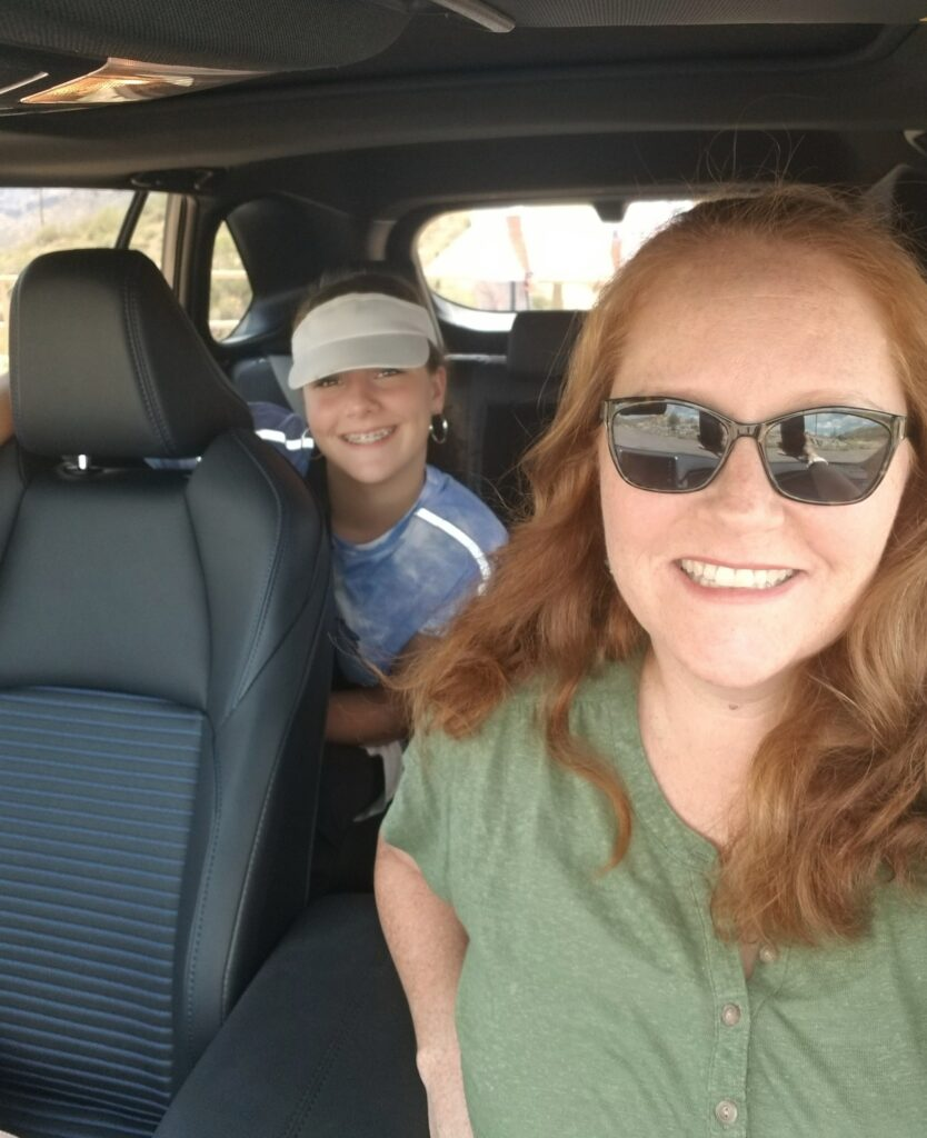 Author and daughter sitting inside RAV4