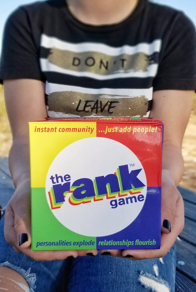 Girl holding The Rank Game box