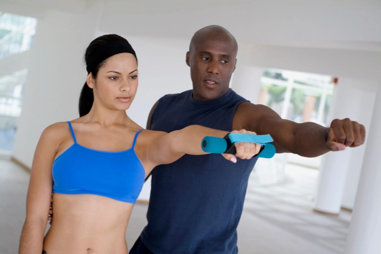 accountability partner training woman with dumbbell