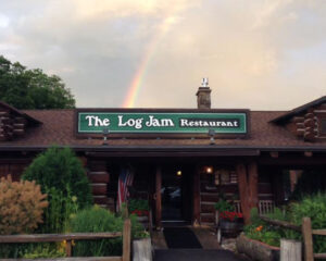rainbow over log jam restaurant sign lake george outlets