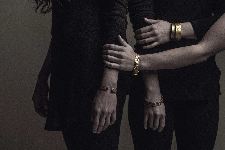 The Jewel - Todd Pownell Tap - Lookbook - Models Wearing Gold Bracelets