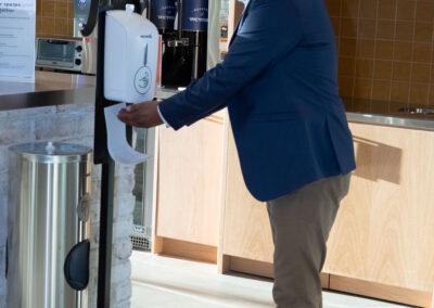 Men using hand sanitizer