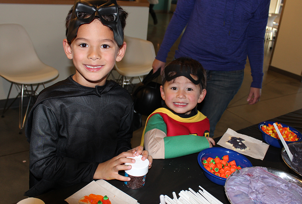 little boys dressed up as batman and robin