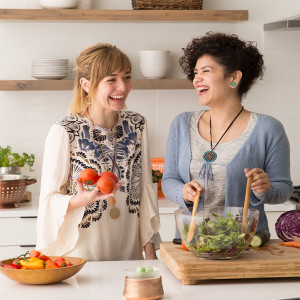 photo of friends making salad