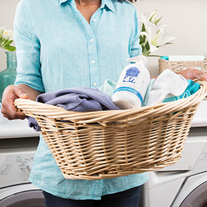 Photo of woman holding laundry basket with scentsy laundry