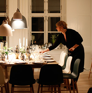 Photo of woman setting the table