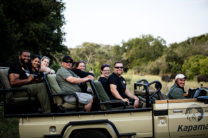 Photo of consultants in Jeeps during their African Safari Trip