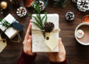 Photo of woman holding gift box present