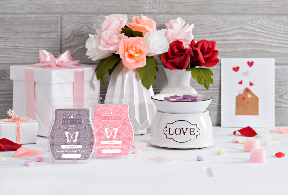 Photo of love warmer with pink haze and lucky in love setting on a valentine's themed table
