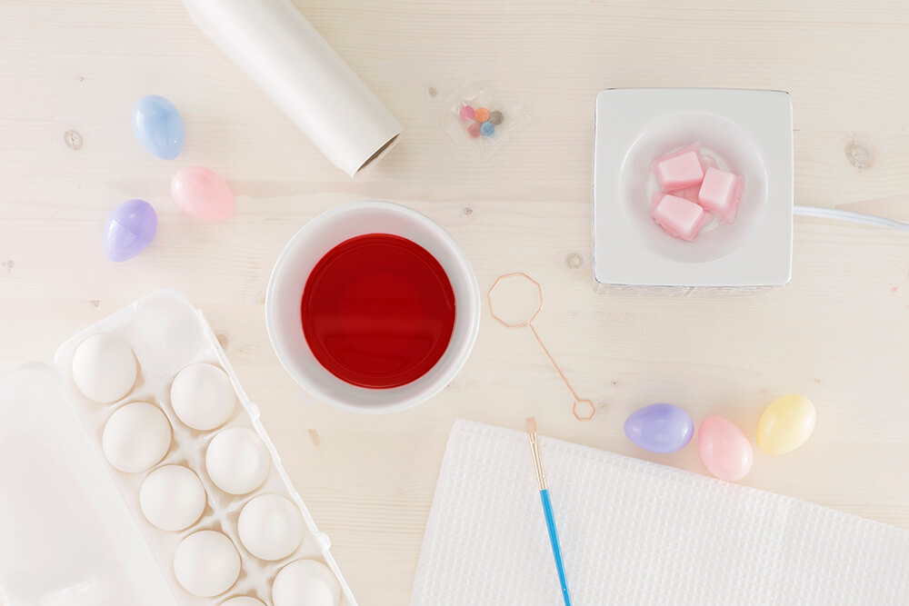 Above photo view of a table with egg dying material and a Scentsy Warmer