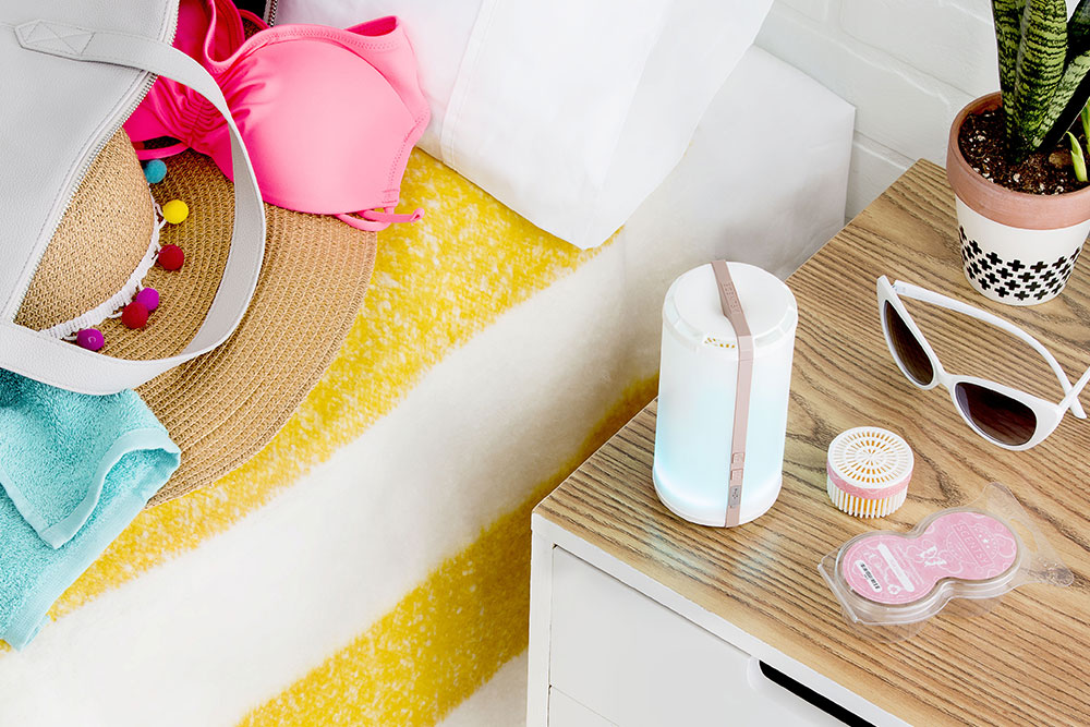 Photo of Scentsy Go on a night stand next to summer tote bag, sunglasses and swim suit