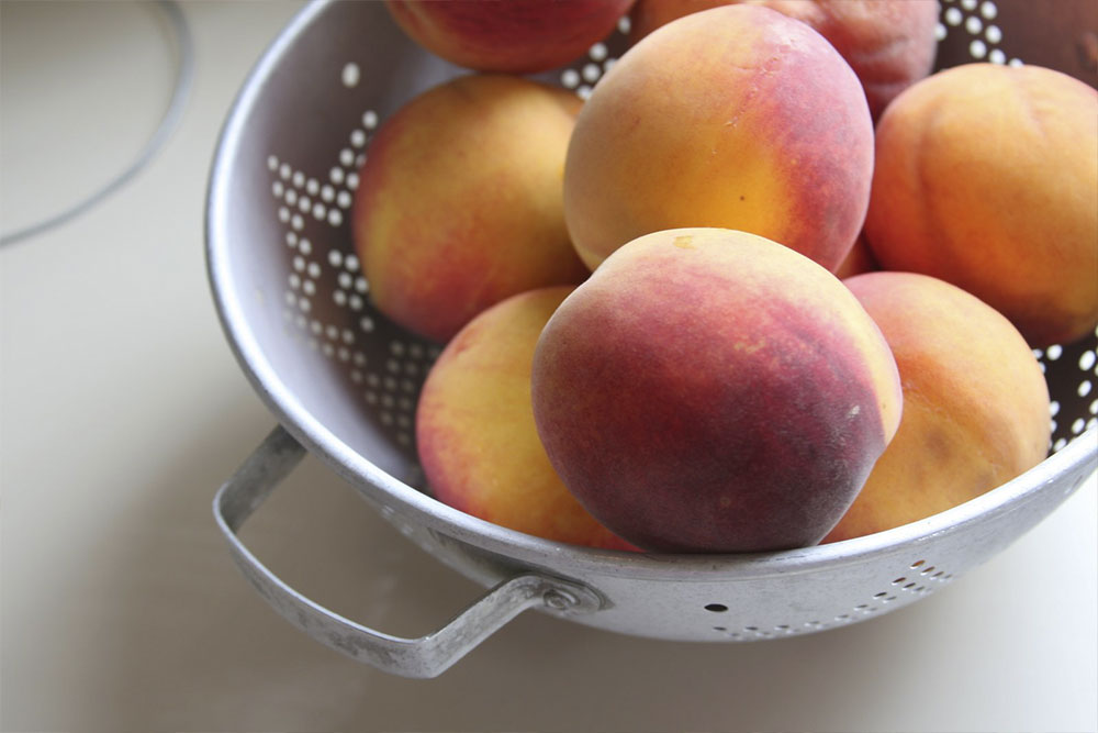 photo of fresh peaches in a colander