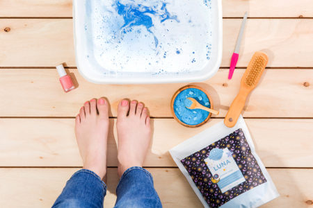 Photo of woman's prepping her feet for soaking them in Scentsy Soak