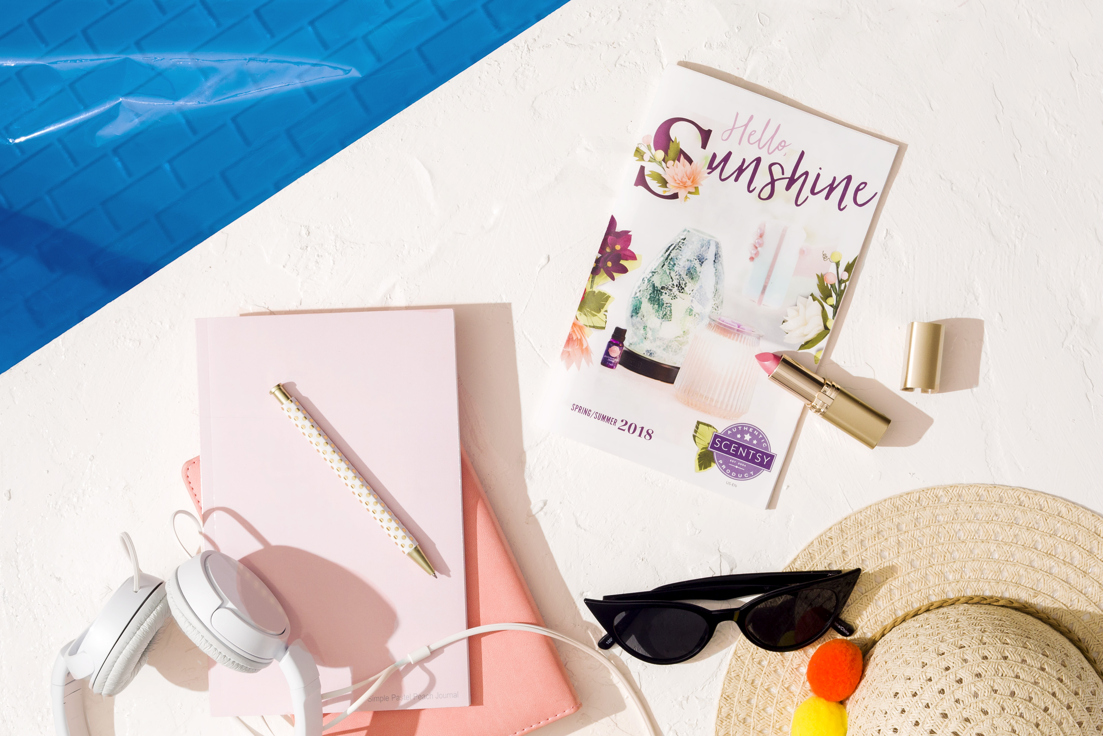Photo of Spring/Summer Catalog with Summery hat and sunglasses