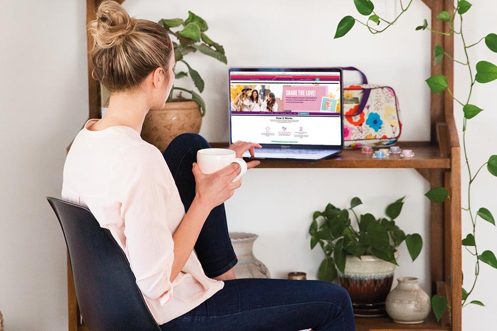 photo of consultant working on her computer