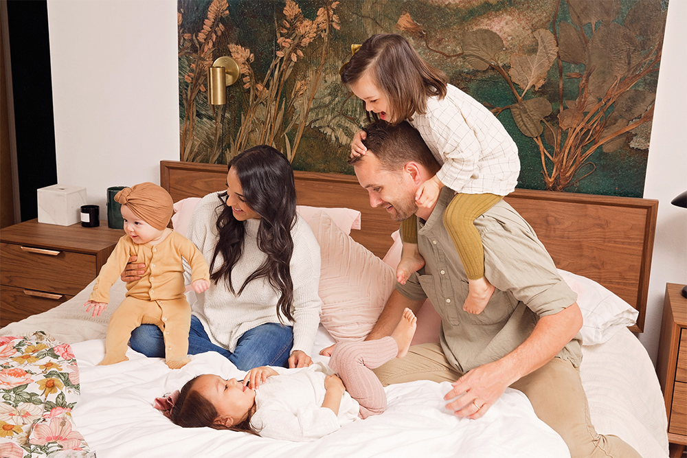 Photo of family playing on bed
