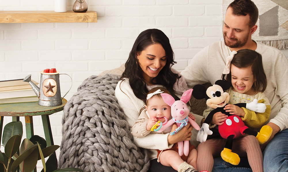 Photo of a cozy couple with their little girls