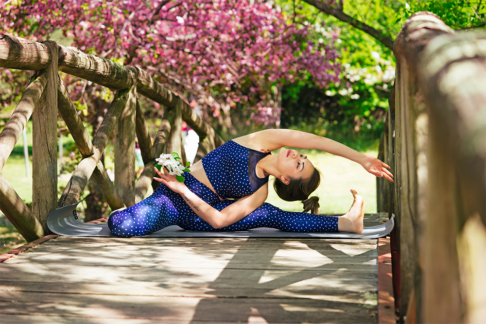 Photo of woman doing yoga in the morning