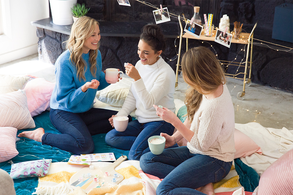Photo of consultant having a party with her friends and smelling Scentsy testers