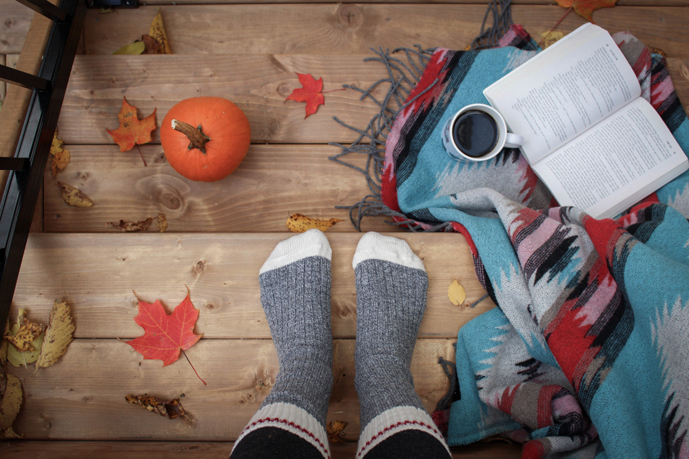 Photo of Hygge Themed decor, fall leaves, stockings, warm cofee