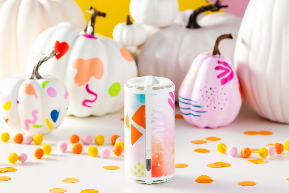 Photo of Scentsy Go with colorful wrap in front of pumpkins