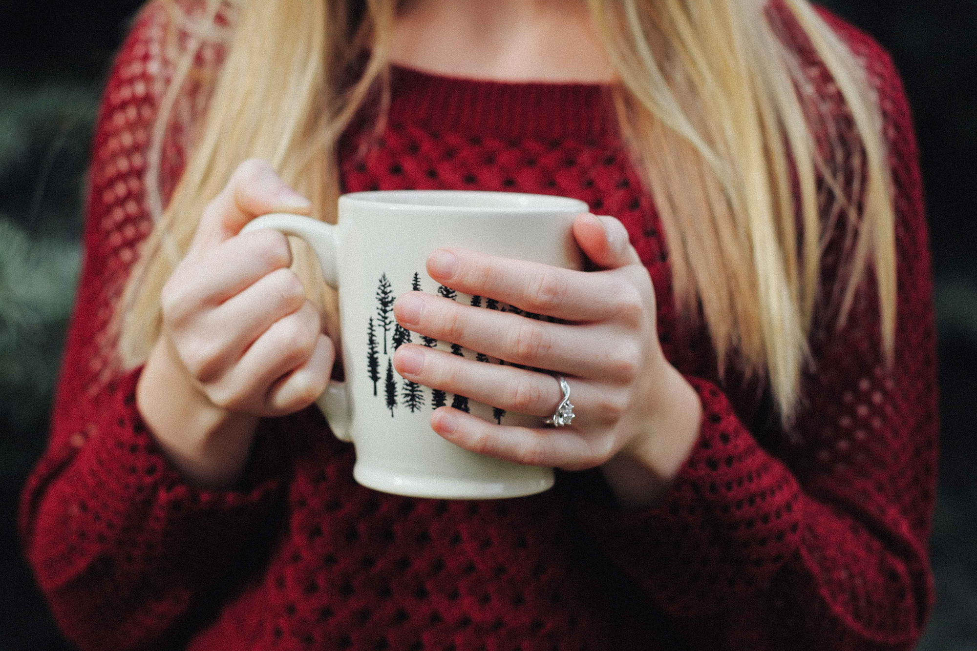 Photo of woman drinking hot coco