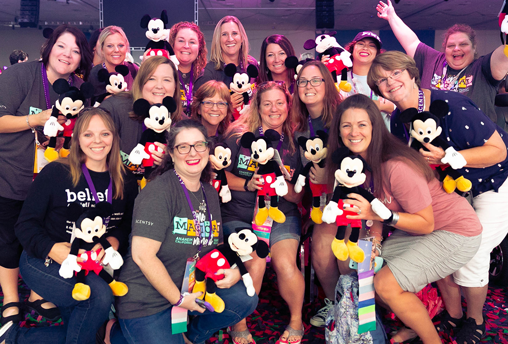 photo of dozens of consultants showing off their scentsy mickey buddy