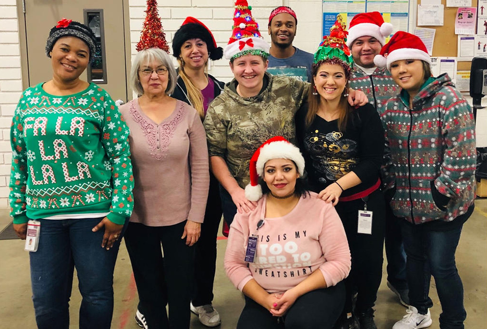 Photo of Scentsy Employees in their Holiday sweaters and hats