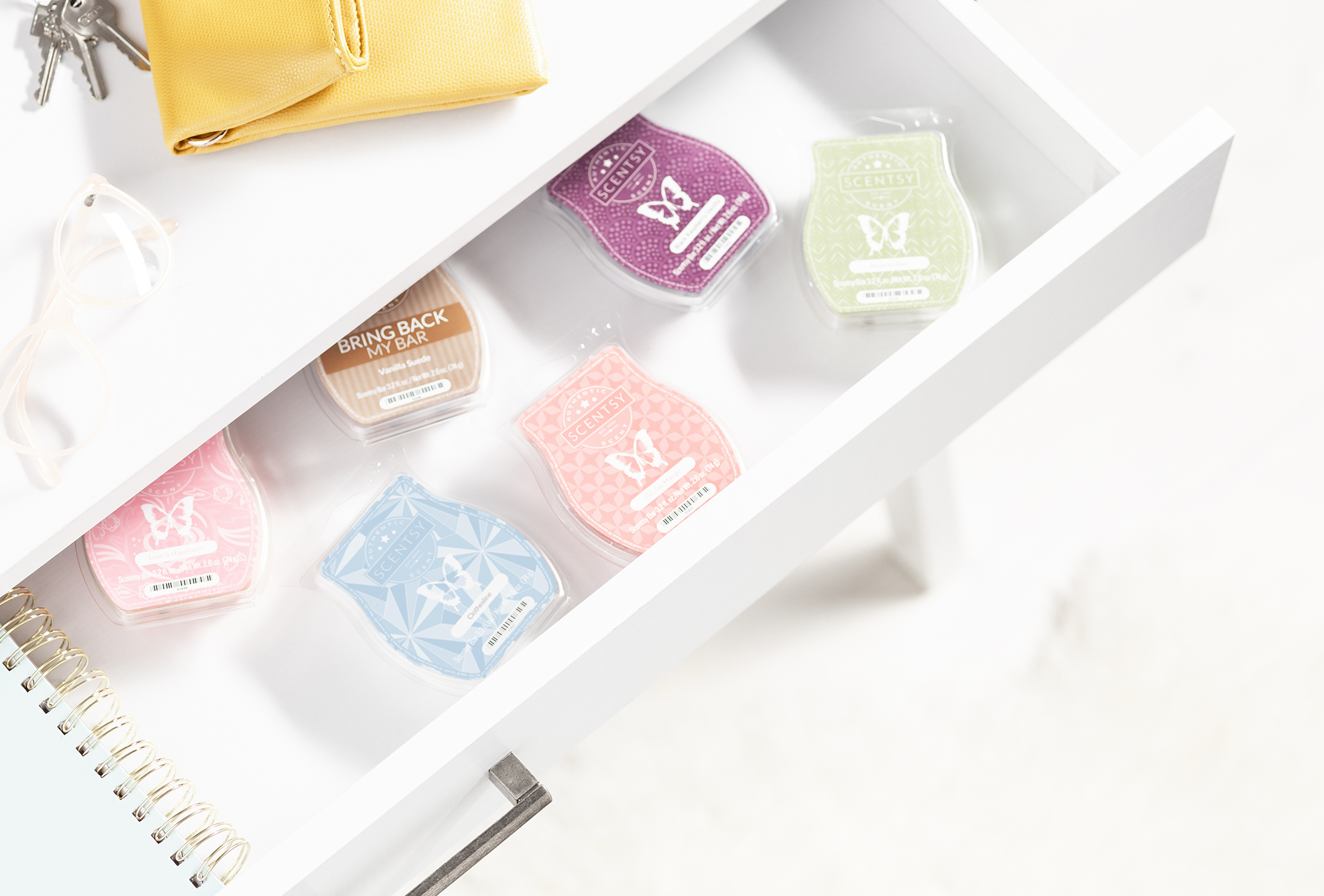Scentsy clam shells in a open drawer