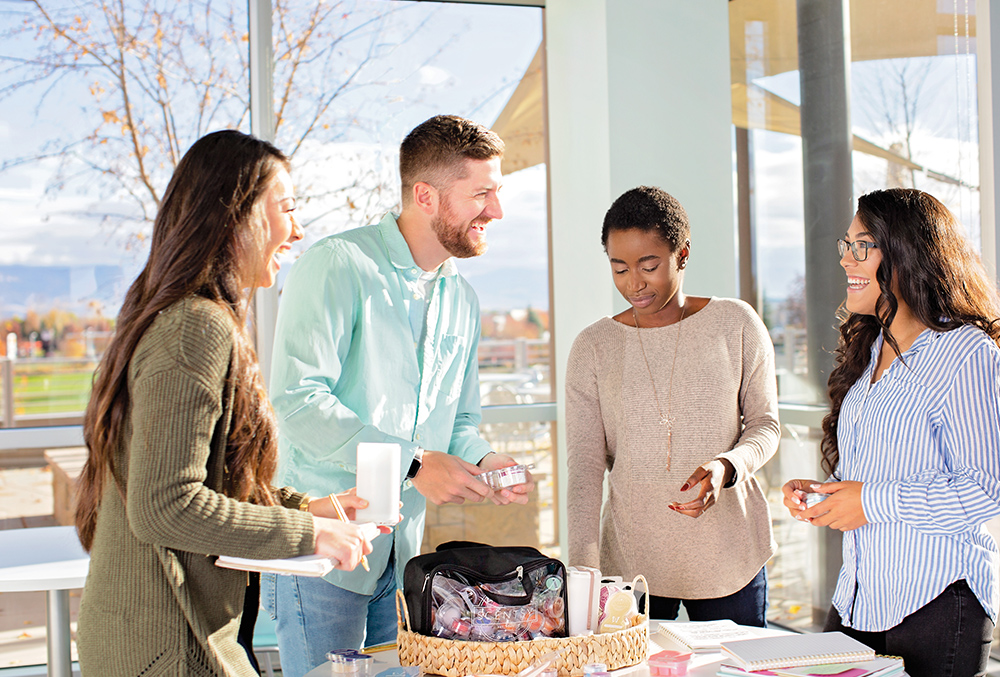 Photo of Scentsy party with consultants and customers discussing Scentsy products