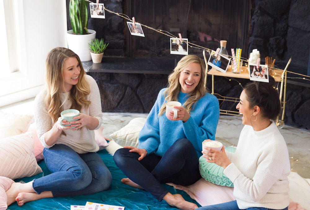 consultants laughing at a hygge themed scentsy party
