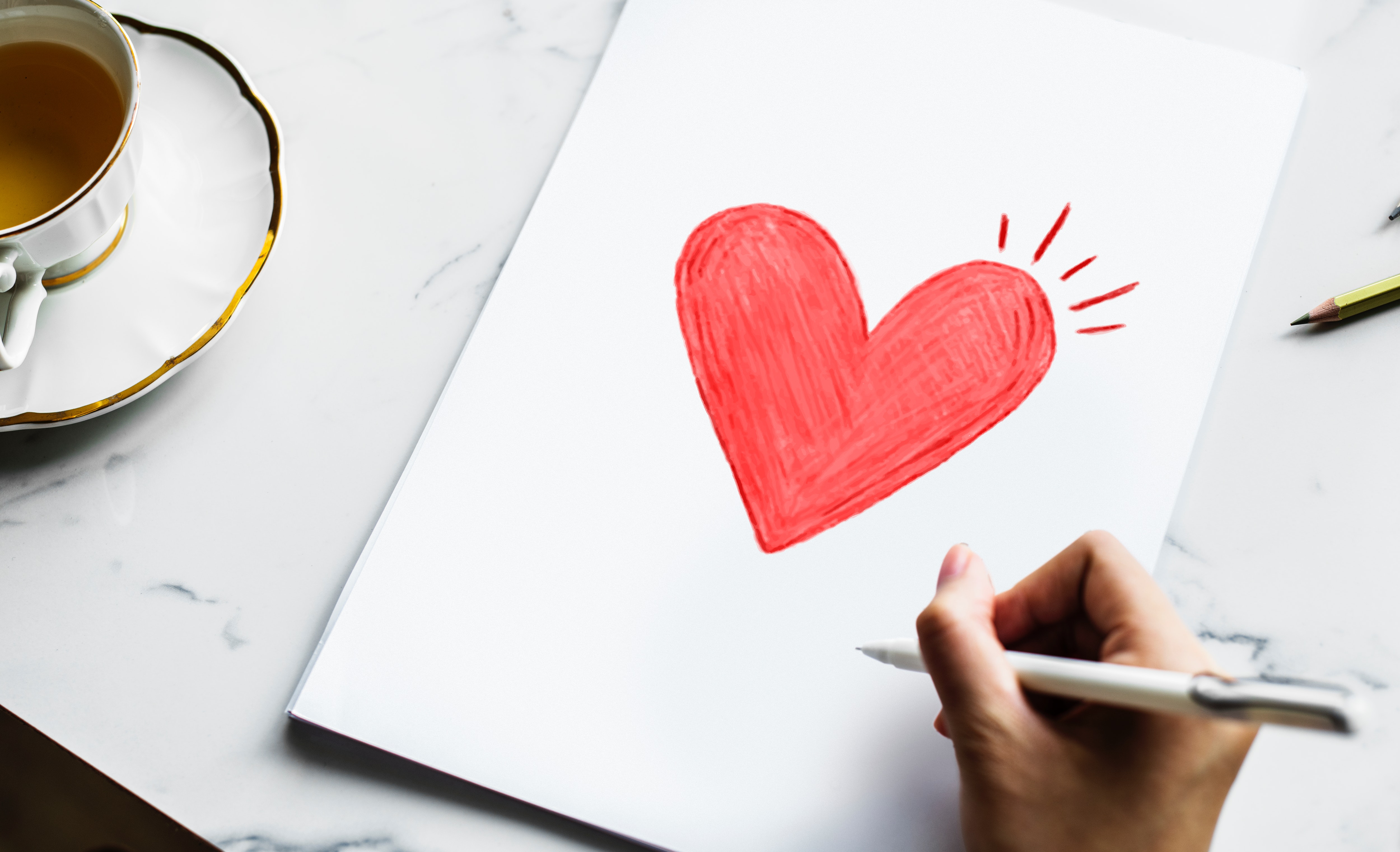 woman creating diy valentine card with crayon
