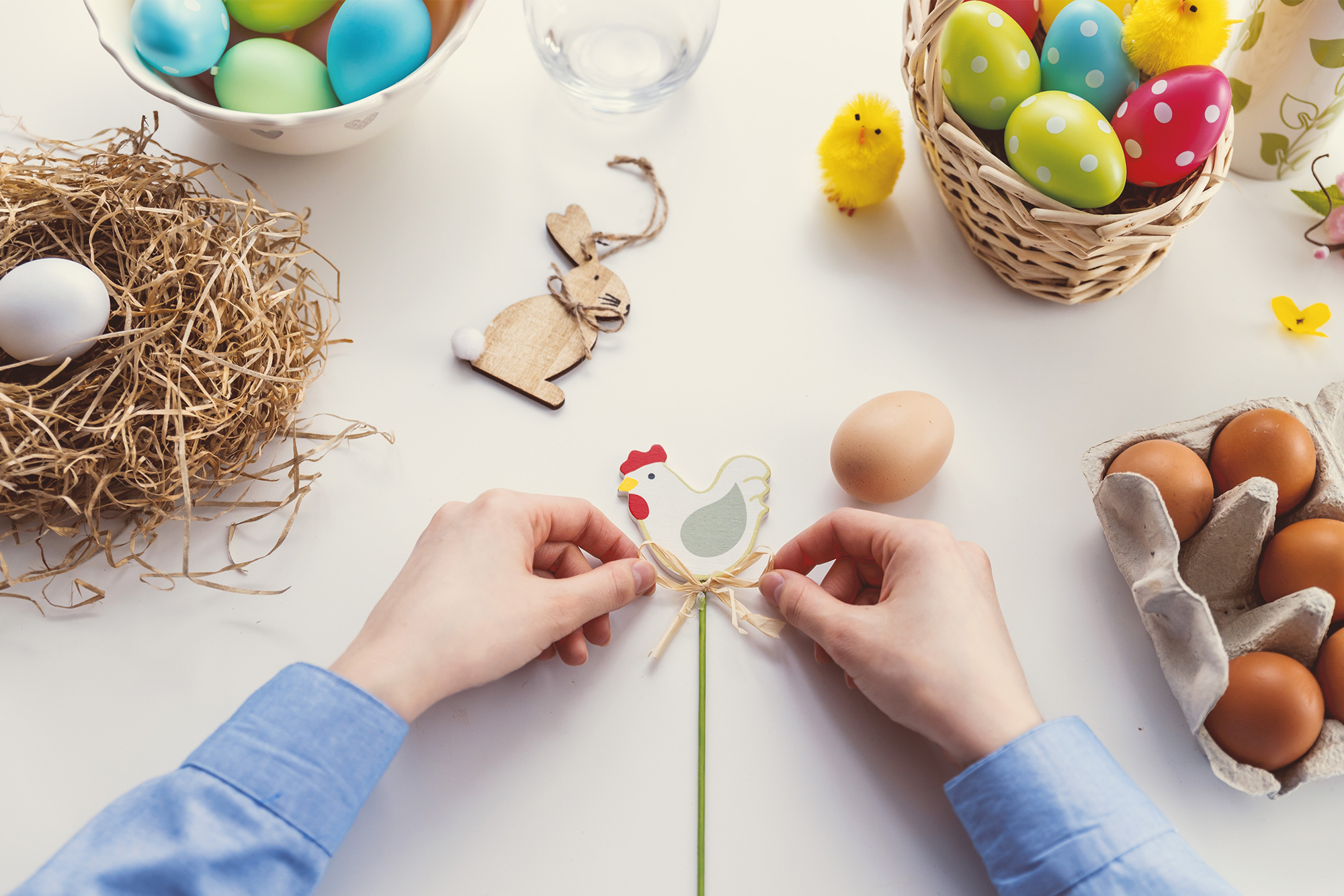 woman preparing easter eggs and easter decorations