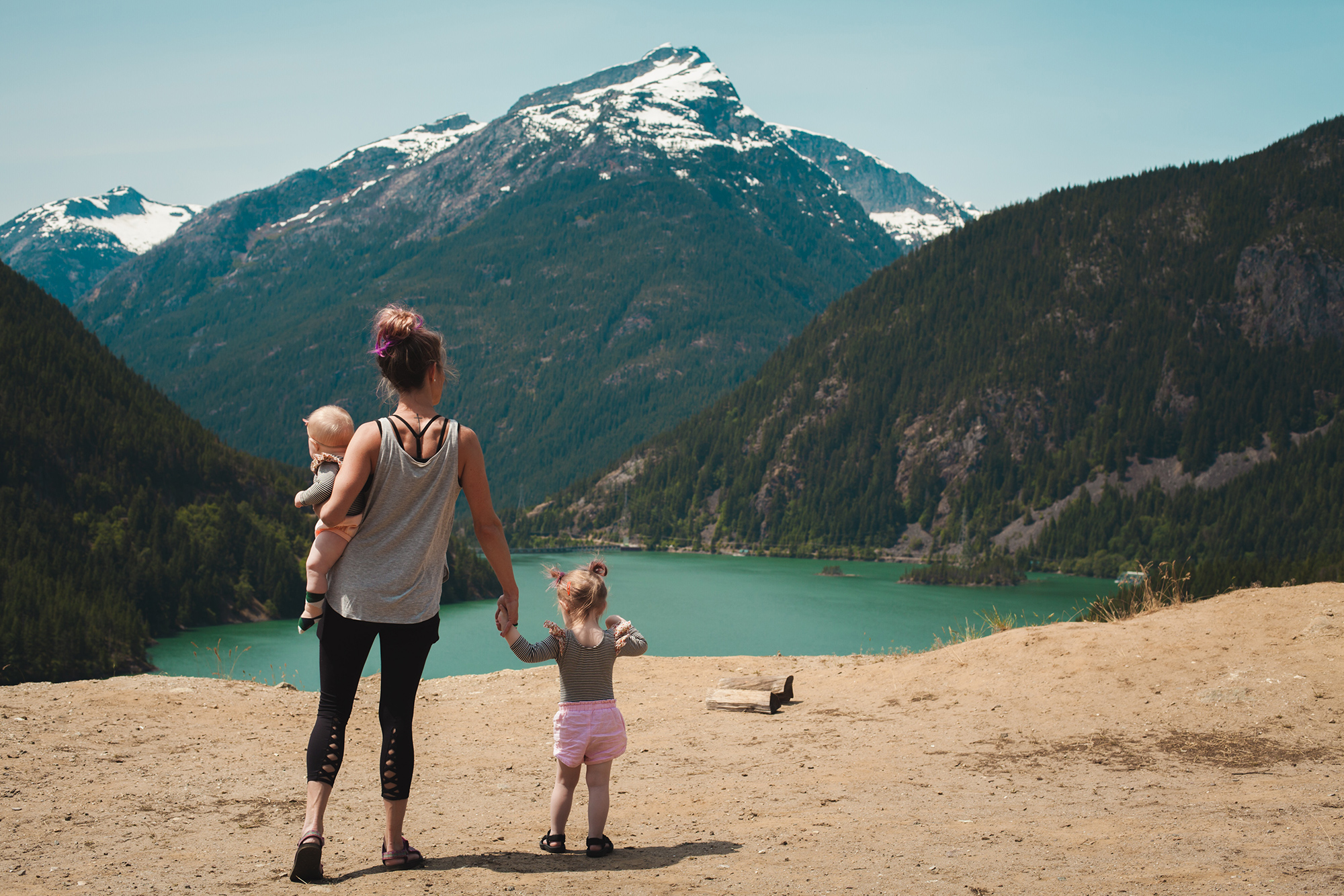 Mother and kids standing over a scenic park view