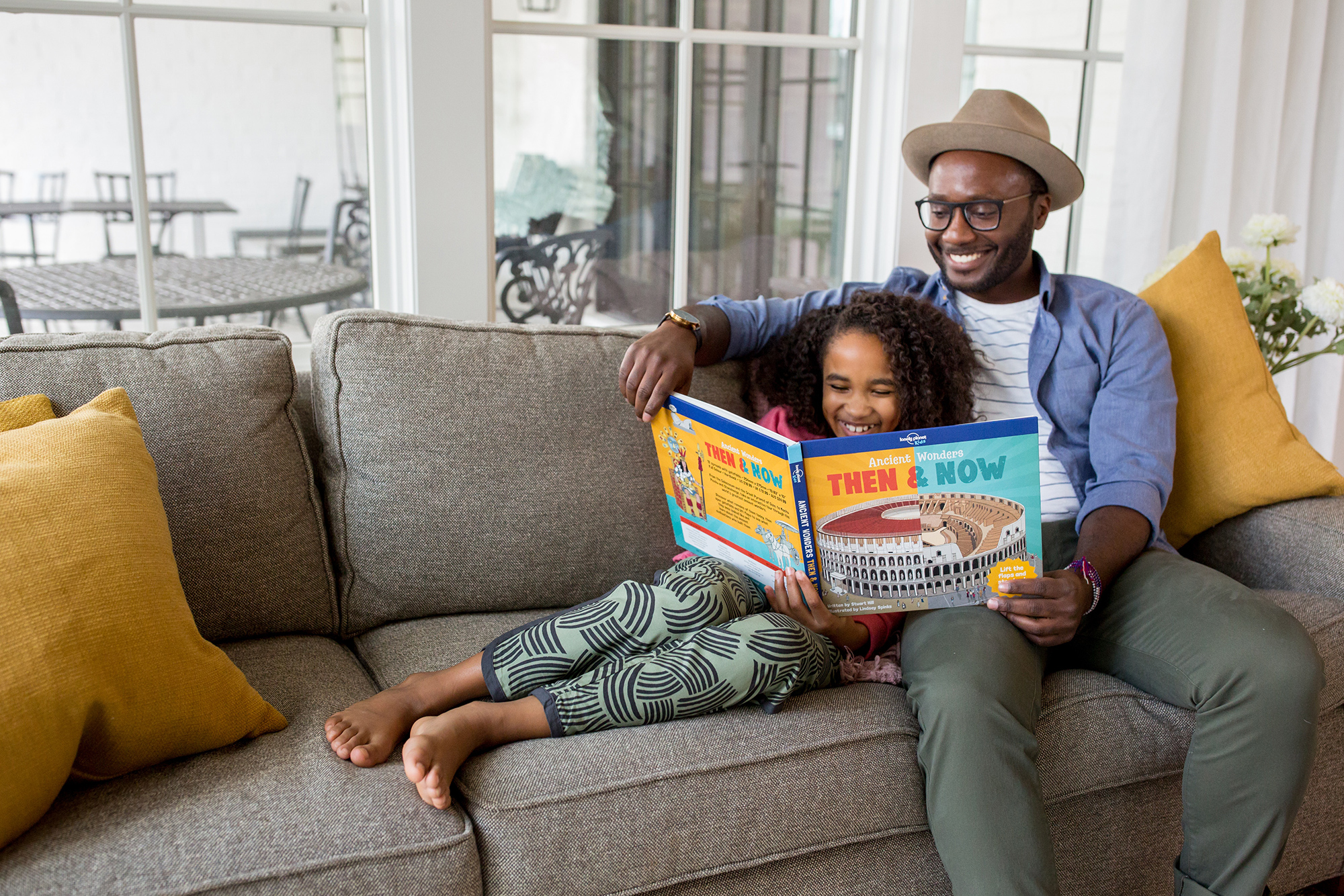 Father and daughter reading book together