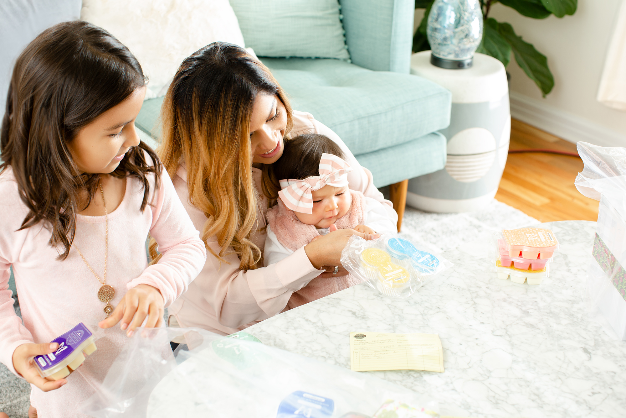 Family looking at Scentsy fragrances