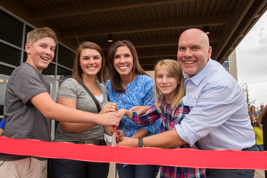 Heidi, Orville, and the kids open the Scentsy Commons