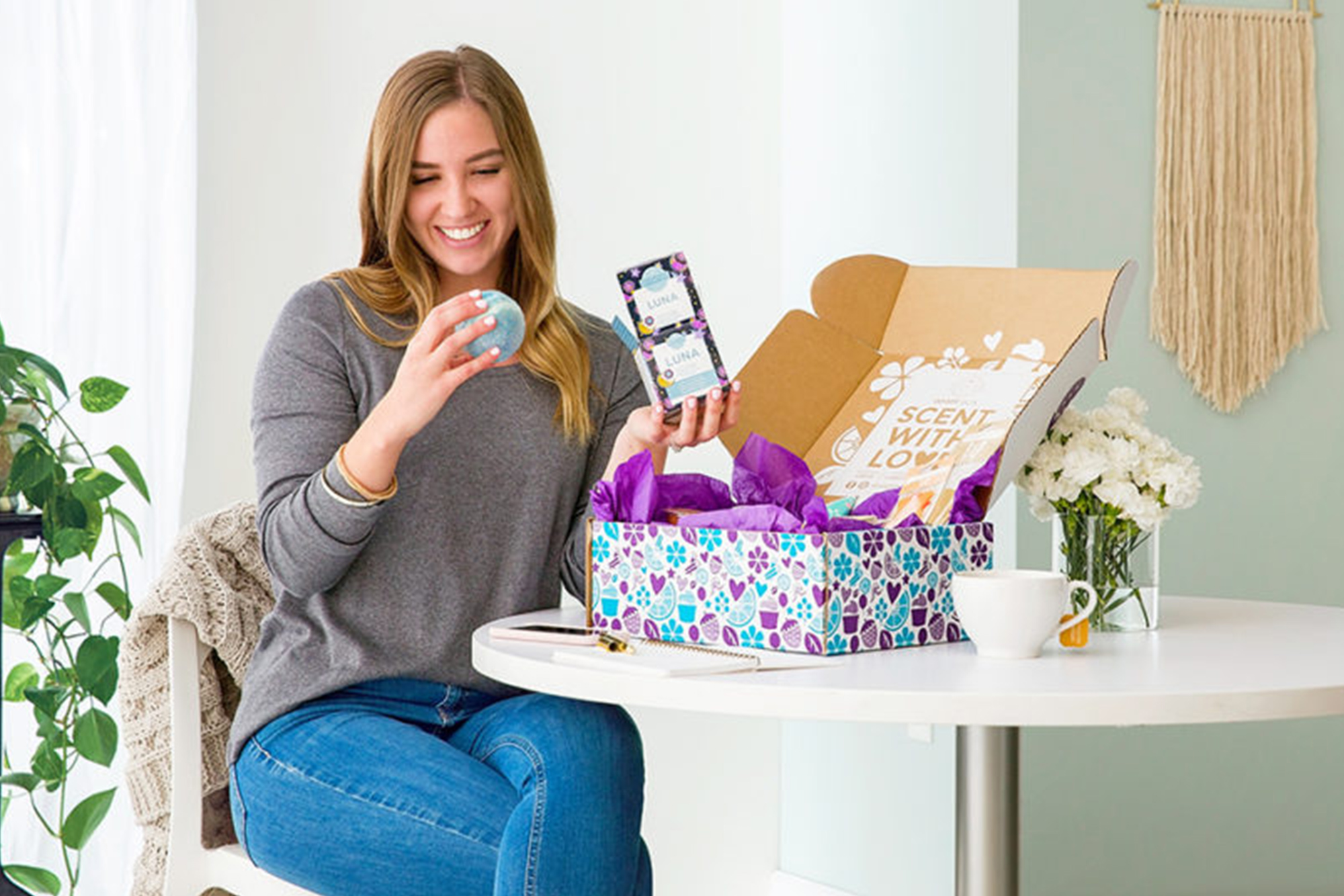 Woman is happy to be opening a whiff box