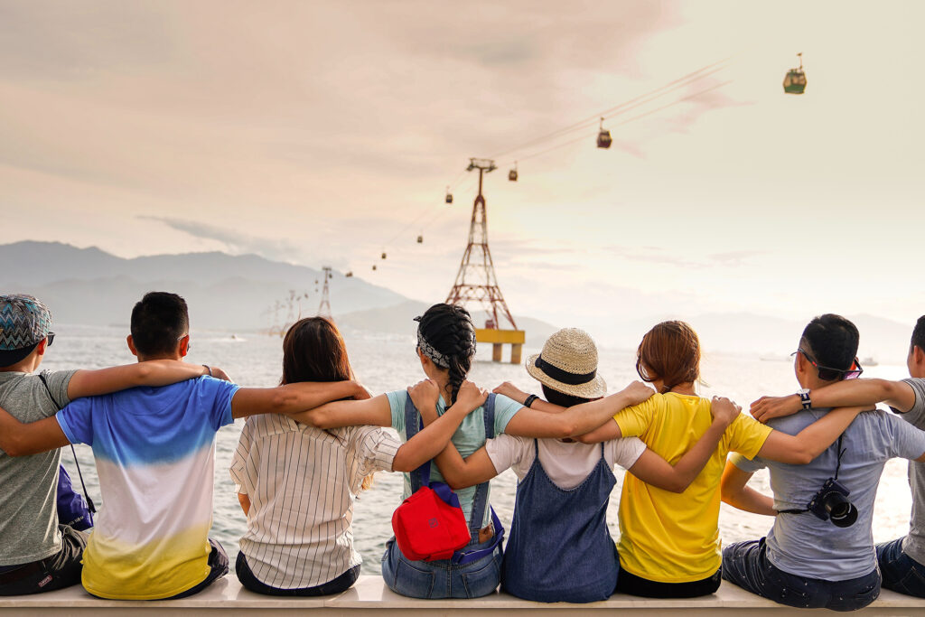 Group of friends watching sky trams move across the sky