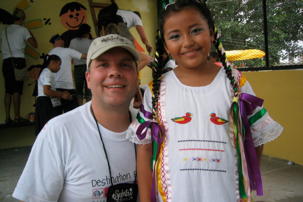 Photo of Orville with Student from Cancun Incentive Trip