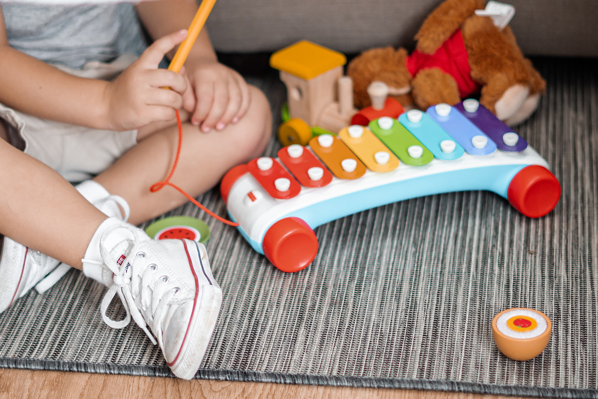 Child playing a xylophone