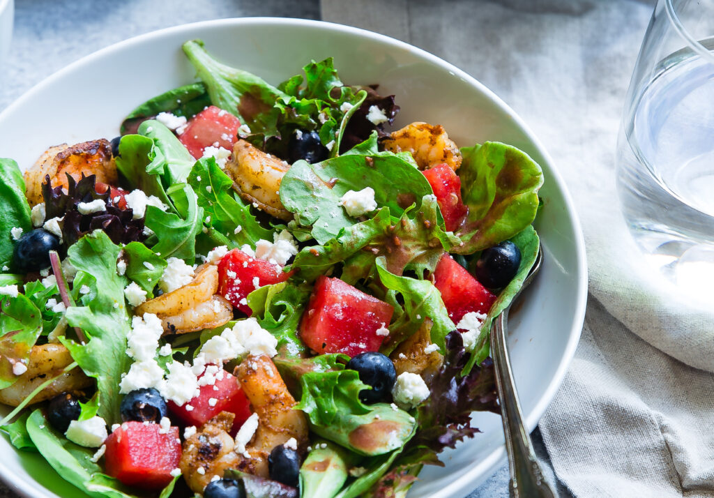 Caesar salad with watermelon tossed in
