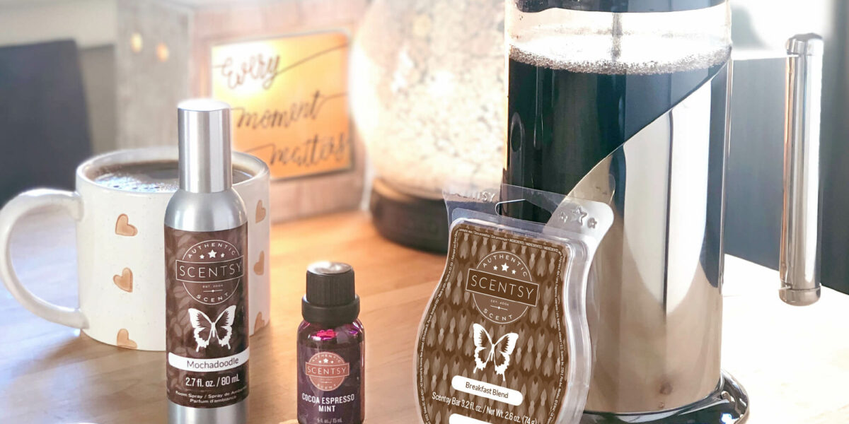9/26 blog post photoshoot featuring - Every Moment Matters Warmer, Enchant diffuser, Mochadoodle Room Spray, Cocoa Espresso Mint Natural Oil, and Breakfast Blend Scentsy Bar