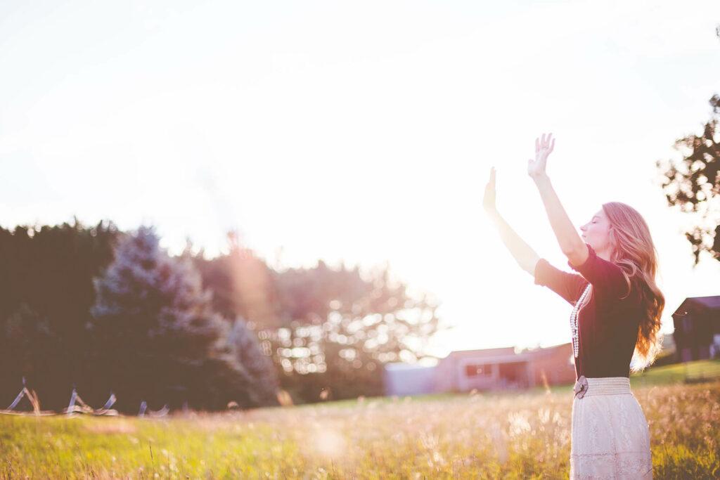 Woman standing in a field relaxing