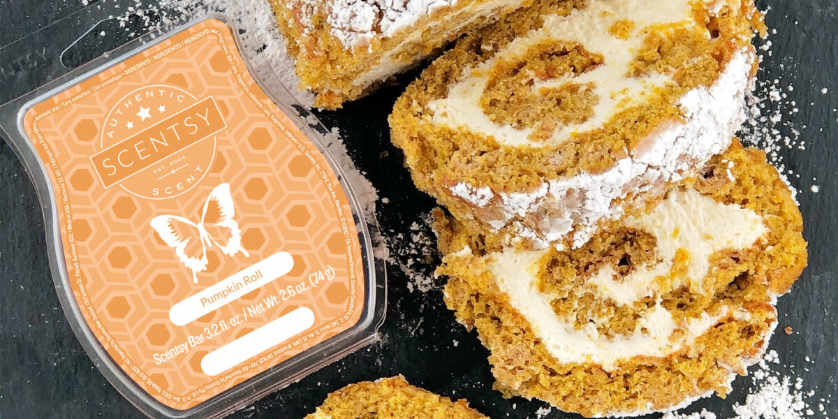 Pumpkin roll Scentsy wax bar next to powdered pumpkin roll