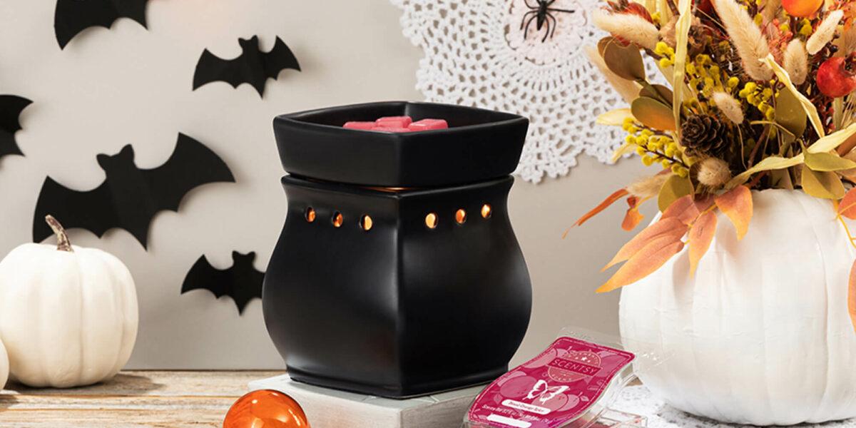 Halloween Inspired scene: Black Classic Curb Warmer with orange lightbulb and blood orange spice