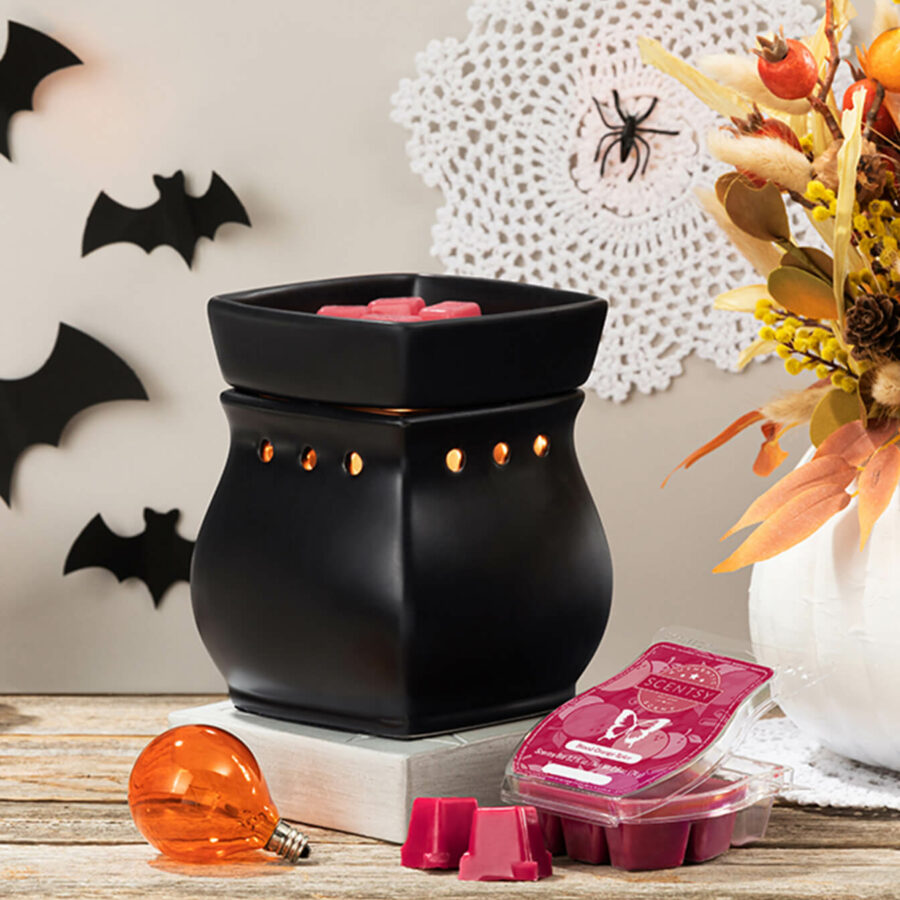 Halloween Inspired scene: Black Classic Curb Warmer with orange lightbulb and blood orange spice