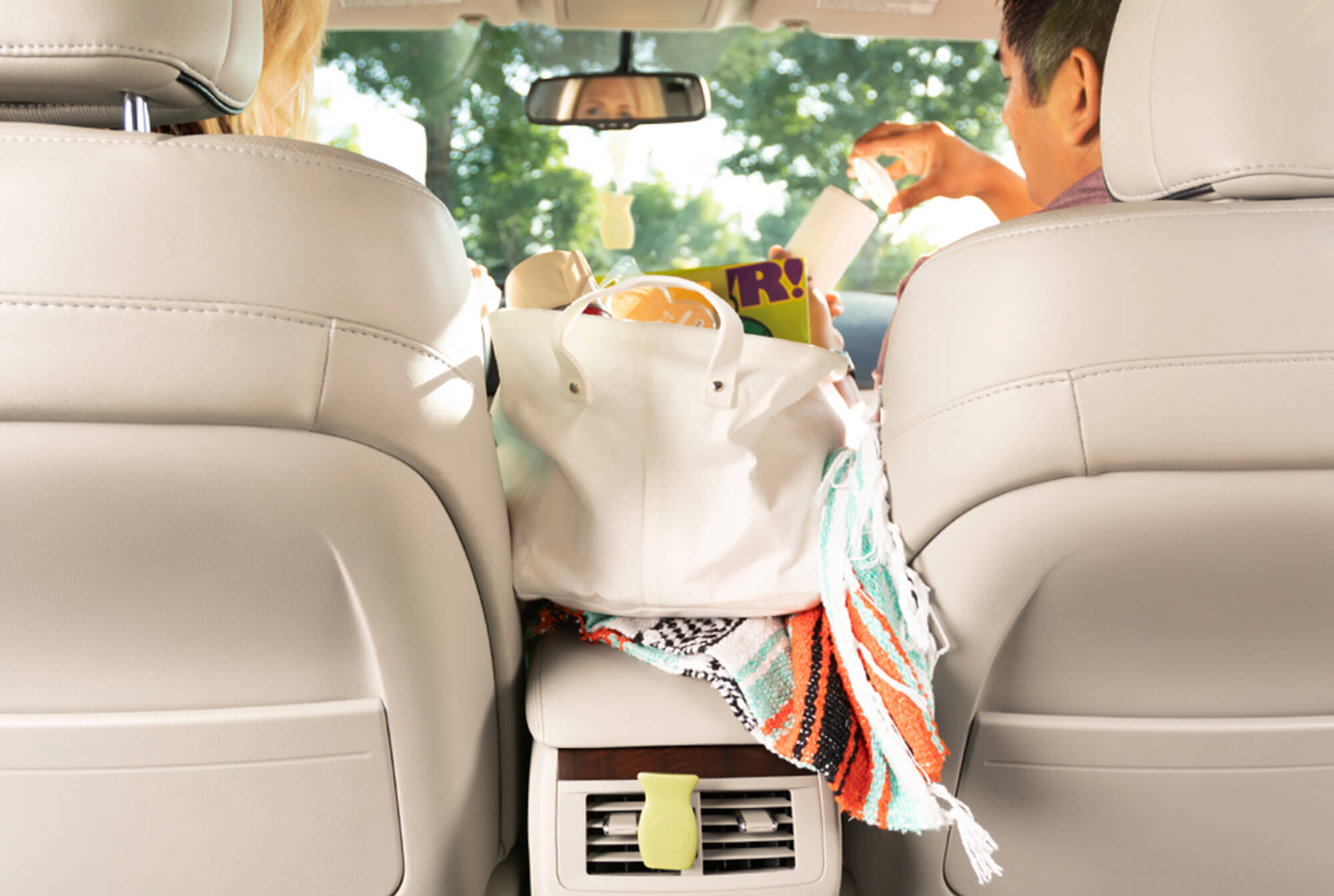 Family getting ready to go on a roadtrip with all their Scentsy essential items