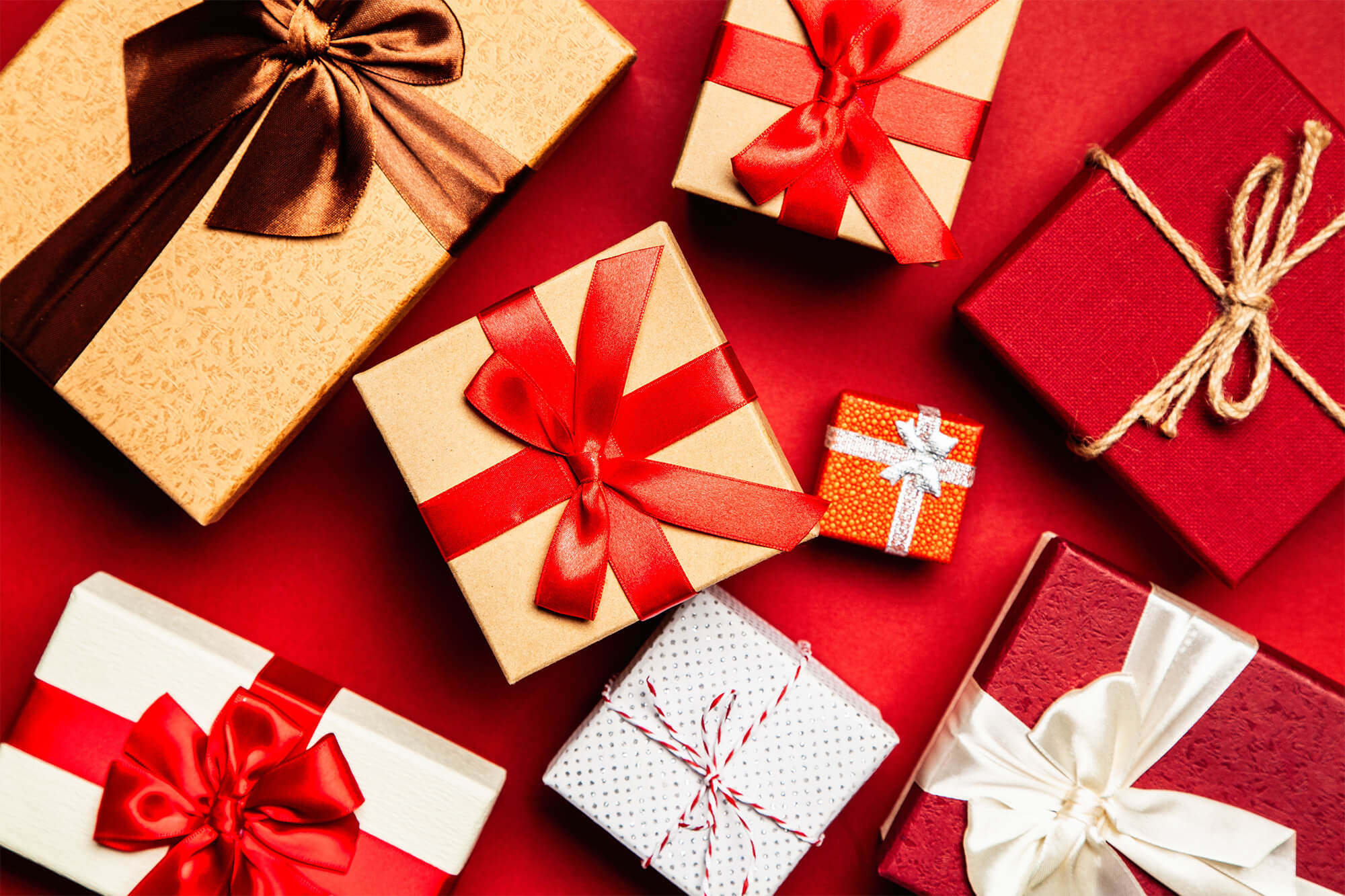 Wrapped presents on a red background
